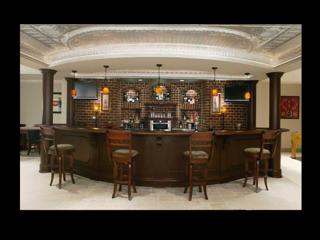 Curved entertainment bar in basement